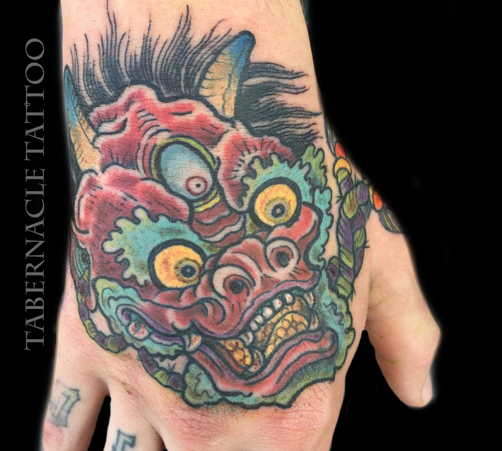 Hand tattoo of oni